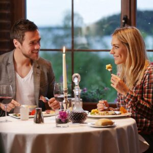 couple-enjoying-evening-meal